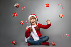 Girl in the hat of Santa Claus with a cup Stock Photos