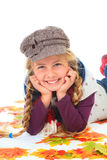 Girl with hat and scarf between autumn leaves Stock Photo