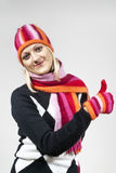 Girl in a hat with a scarf and gloves Stock Photo