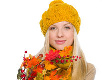 Girl in hat and scarf holding autumn bouquet Royalty Free Stock Photography