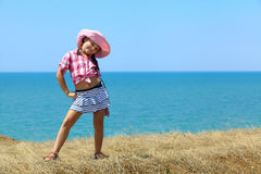 Girl in a hat on the sea Stock Images