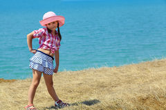 Girl in a hat and skirt Royalty Free Stock Photos