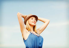 Girl in hat standing on the beach Stock Photo