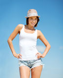 Girl in hat standing on the beach Royalty Free Stock Photo