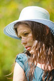 Girl in a hat on a summer day Royalty Free Stock Photography