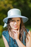 Girl in a hat on a summer day Stock Image