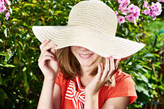 Girl with hat in summer garden Royalty Free Stock Image