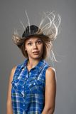 Girl in a hat surprised and her hair fluttering Royalty Free Stock Images