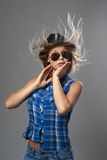 Girl in a hat surprised and her hair fluttering Stock Photos