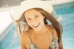 Girl with hat in swimming pool. Girl having fun in swimming pool Stock Photo