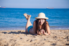 The girl in the hat Tan on the beach Stock Photos