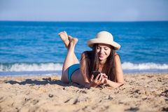 The girl in the hat Tan on the beach Royalty Free Stock Images