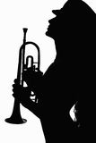 Girl in hat with trumpet Stock Photos