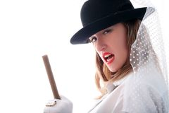 Girl in hat with vail, ring and cigar Stock Image