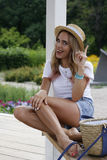 A girl in a hat was visited by an idea. A girl in a straw hat came up with an idea Stock Image
