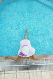 Girl in a hat in the water pool Stock Images