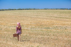 Girl in hat on wheat field Royalty Free Stock Photos