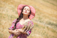 Girl in hat on wheat field Royalty Free Stock Photography