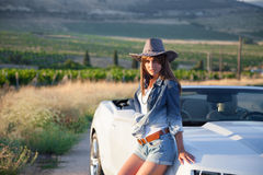 The girl in the hat is white convertible Royalty Free Stock Image
