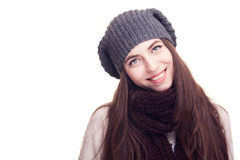 Girl with hat in winter clothes on white background Royalty Free Stock Images