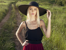 Girl in hat in the woods Stock Photos