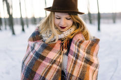 Girl in the hat wrapped in a blanket Royalty Free Stock Images