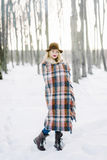 Girl in the hat wrapped in a blanket Royalty Free Stock Photo