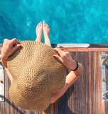 Girl in a hat on a yacht stock images