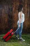 Girl hauling a red suitcase Stock Photo