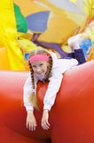 Girl have fun in attraction Royalty Free Stock Image