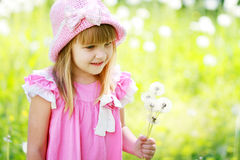 Girl have fun with dandelions Royalty Free Stock Image