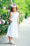 Girl have fun with flowers Royalty Free Stock Photo