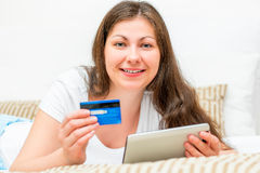 Girl have lot of money on a credit card Royalty Free Stock Image