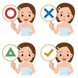 Girl have a plate of sign to answer correct or incorrect Stock Photography