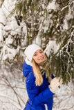 The girl have a rest in the winter woods. Stock Photography