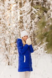 The girl have a rest in the winter woods. Royalty Free Stock Photo