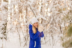 The girl have a rest in the winter woods. Royalty Free Stock Photography