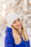 The girl have a rest in the winter woods. Stock Images