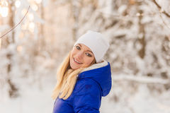 The girl have a rest in the winter woods. Stock Photo