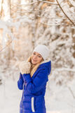 The girl have a rest in the winter woods. Royalty Free Stock Photos