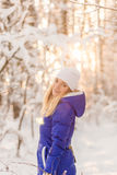 The girl have a rest in the winter woods. Royalty Free Stock Image