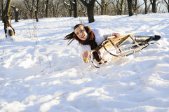 Girl having accident on sledge Stock Images