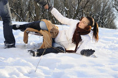Girl having accident with sledge. White young woman having accident with sledge in winter season Stock Photography