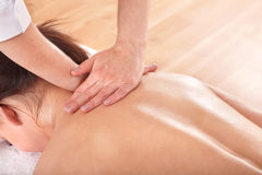 Girl having back massage. Royalty Free Stock Images