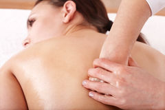 Girl having back massage. Royalty Free Stock Photo