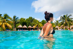 Girl Having a Bath in a Tropical Pool Stock Photos