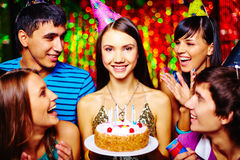 Girl having birthday. Attractive girl with birthday cake and her friends having party stock images