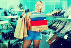 Girl having boxes with new pairs of shoes Royalty Free Stock Photos
