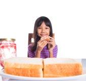 Girl Having Bread Toast III Royalty Free Stock Photo