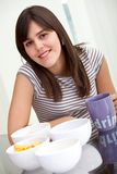Girl having breakfast Royalty Free Stock Photos